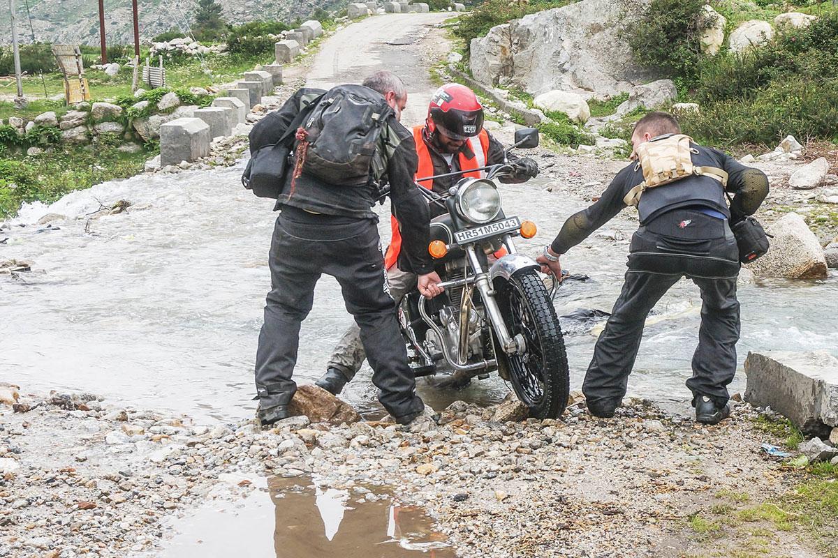 motorbike stuck in rocks