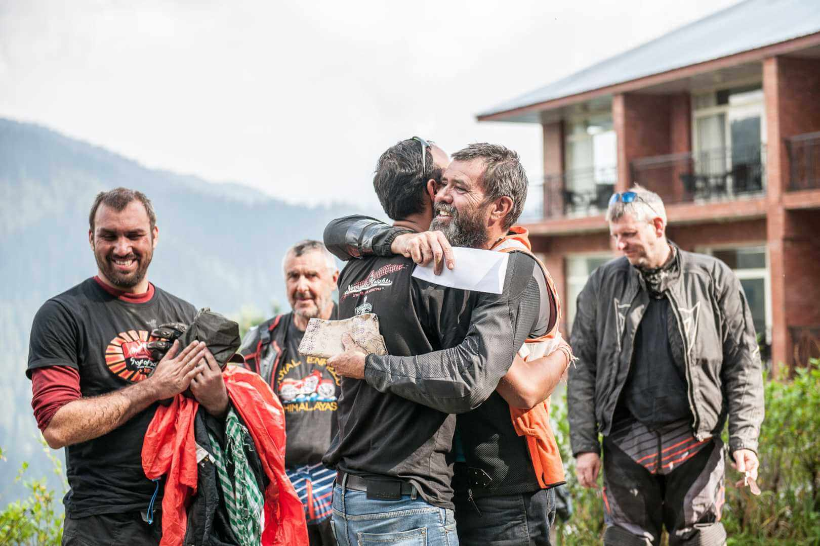 Group of happy motorcyclists in Indian mountain range