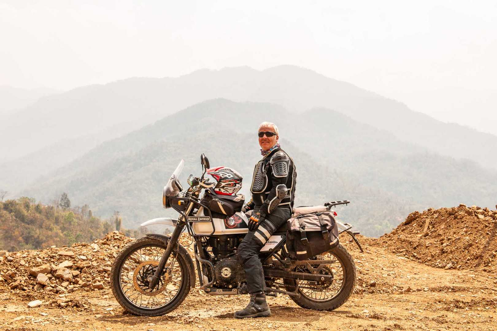 Nomadic Knights motorcyclist riding up rocky mountain