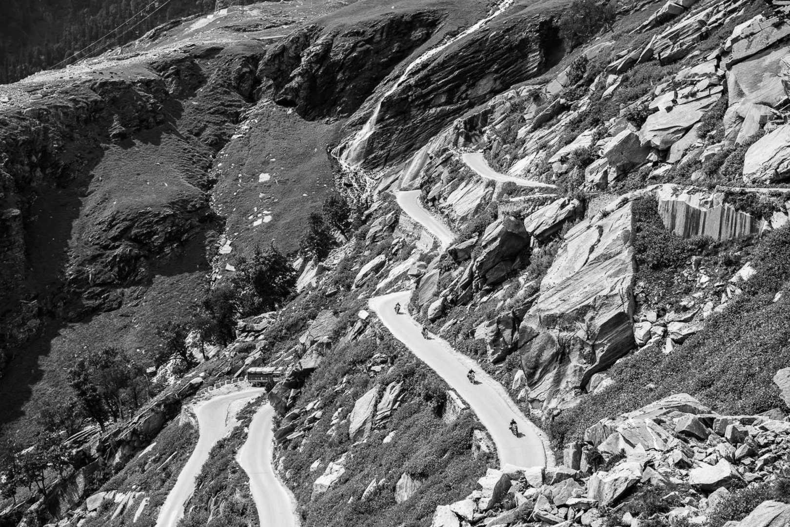 Black and white photo of motorcyclists in the himalayas