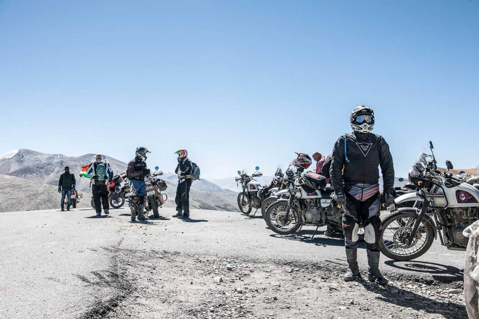 Motorcyclists overlooking the Himalayas