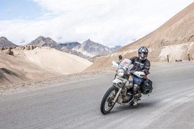 Motorcyclist driving through Himalayas