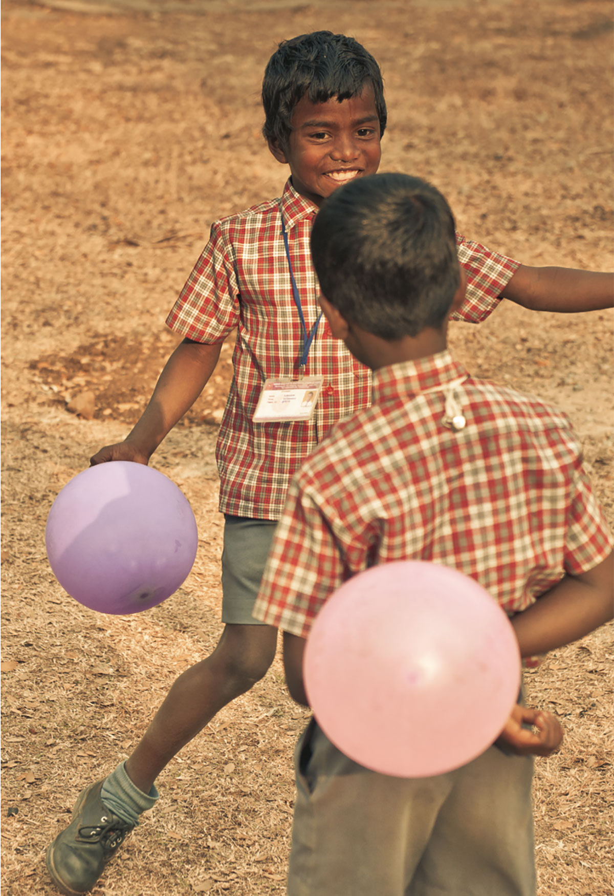 Indian children with balloons